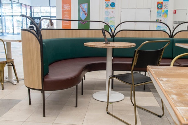 Retro style curves and plump upholstery drawn on the design influences of New York cafes