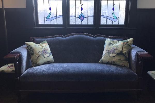 Sunlit Sydney room with shimmering velvet upholstery